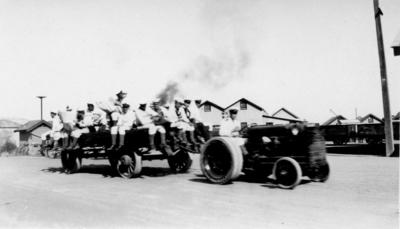Sailors on the back of a tractor