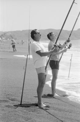 Basil Savage, left, and his son Wayne surfcasting
