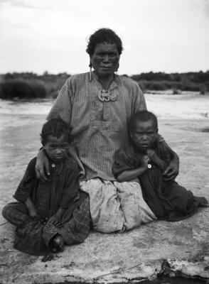 A portrait of a woman and two children