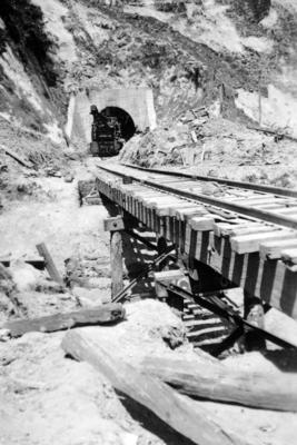 A railway crane in front of a tunnel on the East Coast railway line