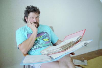 Bryan Forrest looks through his curriculum vitae