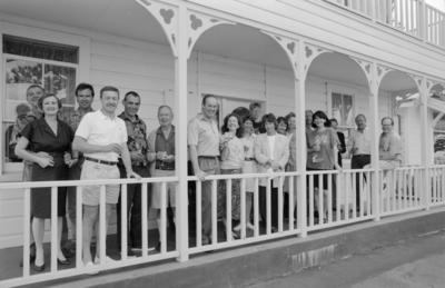 Travel industry leaders pose outside the Mon Logis Guest House, on the Marine Parade