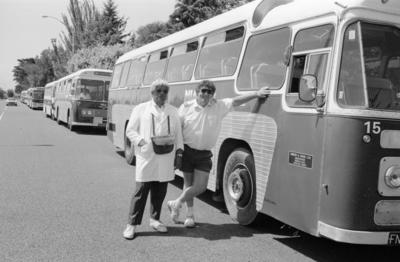 Reuben Parahi on left, a busfare attendant and driver Jack Booth