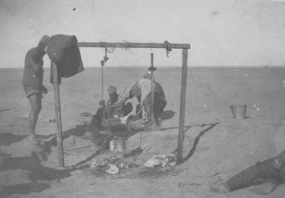 Men in the desert killing sheep