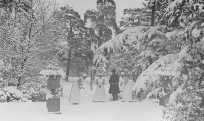 Three nurses and a gentleman playing in the snow