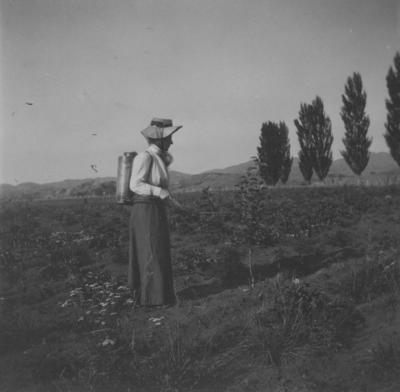 Bessie Spencer in orchard, Omatua, Rissington