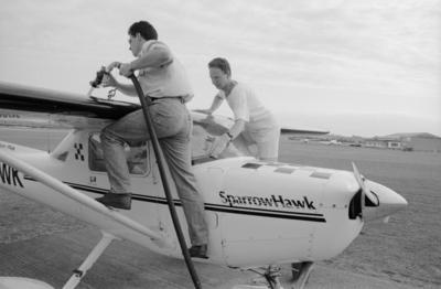 Darran Kyle on the left and Kery Hoare prepare a Cessna 152 Aerobat for flight