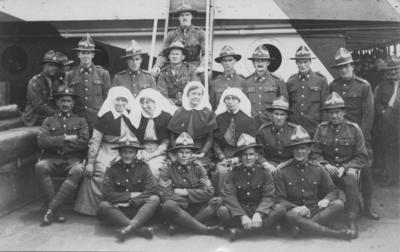 A group of soldiers and nurses on board a ship