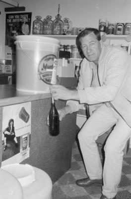 Gordon Hill pouring homebrew