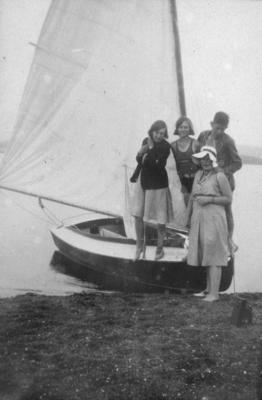 Four unidentified people standing on a yacht