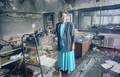 The interior of Napier's urban marae, badly damaged in last week's fire, is surveyed by the voluntary secretary for Te Taiwhenua Whanganui A Orotu, Ngaio Smith Powdrell