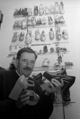 Man with Antique Shoes