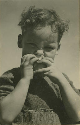 Portrait of young boy eating