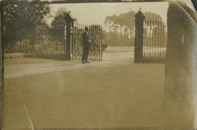 Man at park gates