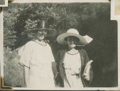 Two women wearing sunhats