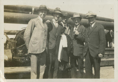 Group of men standing on wharf