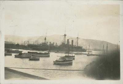 Steamships and small boats in harbour
