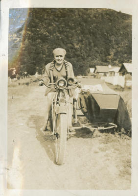 Woman on a motorcycle with sidecar