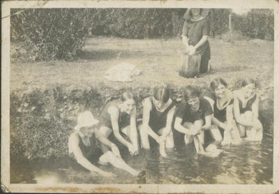 Women bathing and washing in a river