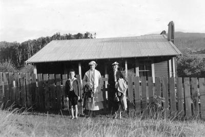 Grace Hall with Mrs Newman and son outside Ohurakura School