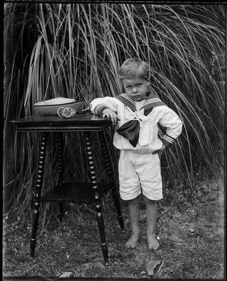 Boy in sailor blouse