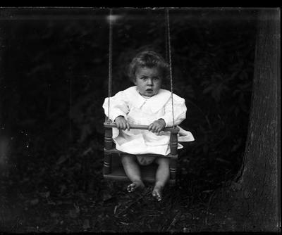 Toddler in swing