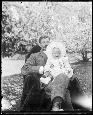 Man holding infant