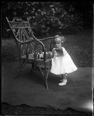 Infant beside chair