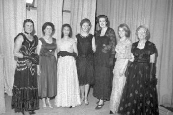 A century of styles at the Taradale Town Hall.  Evening and social wear for the discriminating and fashion conscious dresser are modelled by a group from the St Columba Presbyterian Church.  From left, Mesdames  Nancye Munro, Margaret Goodwin, Margaret Bain, Misses Jan Hughes, June Ashenhurst, Helen McLeod and Mrs Cowen McDonald.
