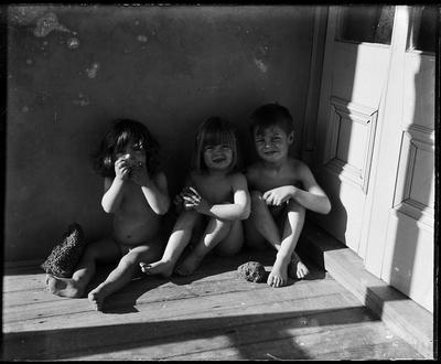 Children seated on deck