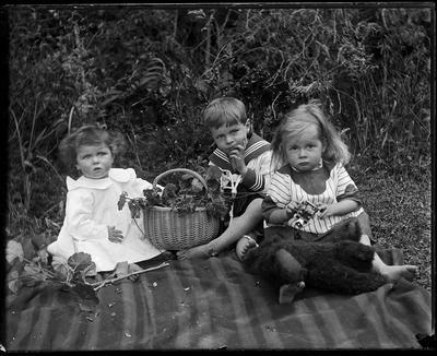 Children seated on blanket