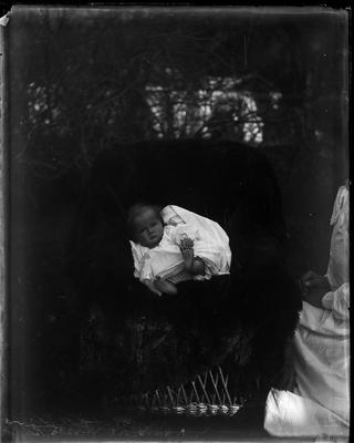 Infant seated on chair