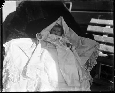 Infant lying on blanket