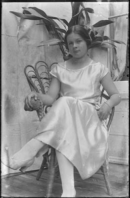 Girl seated in chair