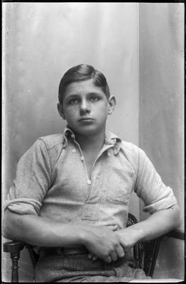 Boy seated in chair