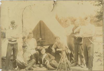 Uniformed men at camp