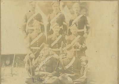 Group of uniformed men including Louis Hay