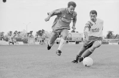 Paul Halford and Olympic midfielder Imre Foldi contest a ball