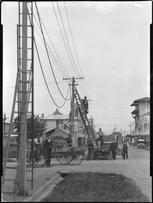 Workers putting up power lines in Hastings