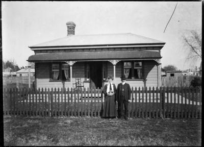 Couple outside house