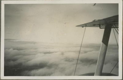 View of clouds from biplane