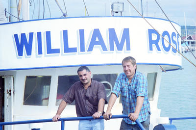 Fishing trawler owners Nino D'Esposito on the left and Mike Terry aboard the William Rose