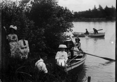 Group seated in dinghy