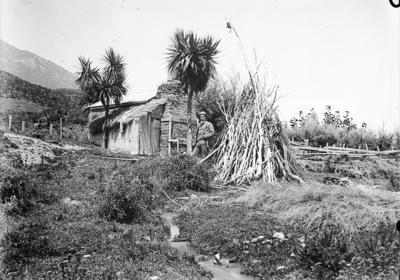 Man standing outside hut