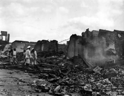 Sailors searching the rubble; Lambourne, Cyril Walter