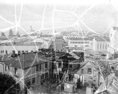 The burned-out rooms in the upper story are seen in this rear view of the Clarendon Hotel. It is thought that the fire started in the rooms shown on the right-hand side
