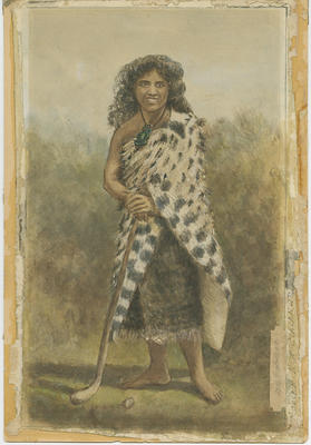 Portrait of a young Māori woman with hockey stick