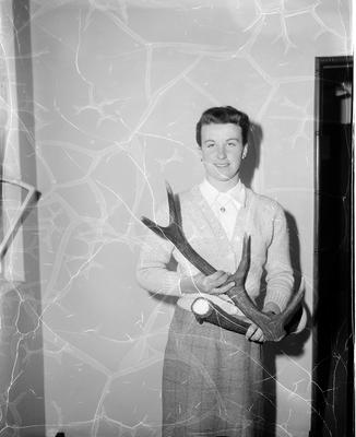 Miss Janet Haliburton with the pair of red deer antlers she found near Tutira