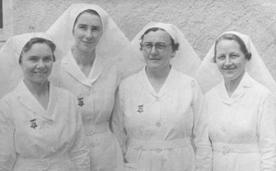 Portrait of four nurses; 2012/42/29