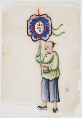 Untitled - person in purple trousers, green top with green sash carrying a banner/placard